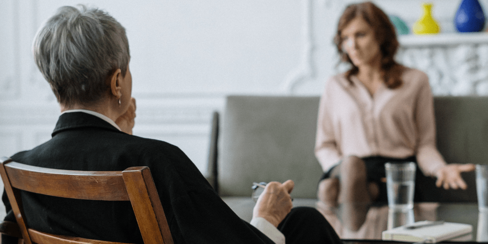 two woman in a psychotherapy session